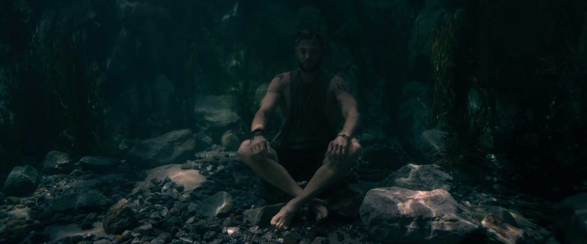 Extraction Still Chris Hemsworth Meditating Underwater